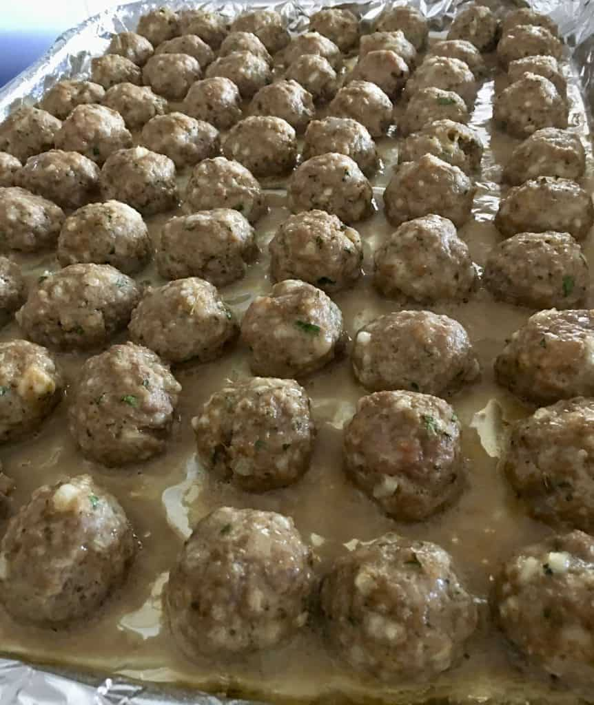 baked meatballs on a foil lined baking sheet