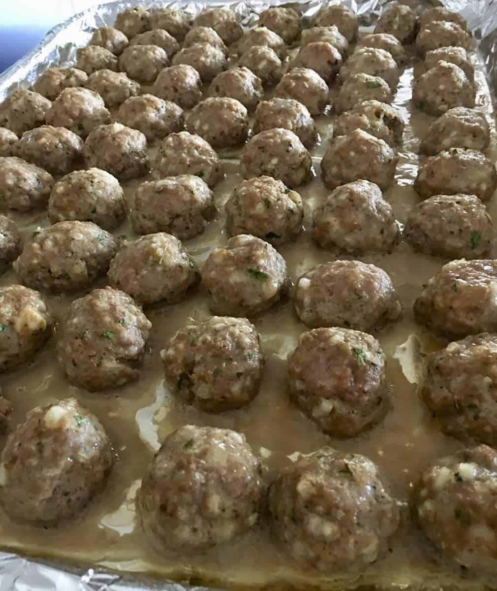 baked meatballs on a foil lined baking sheet