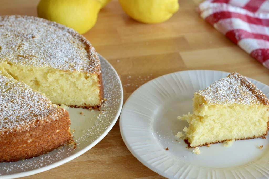 Italian Lemon Ricotta Cake on a white plate.