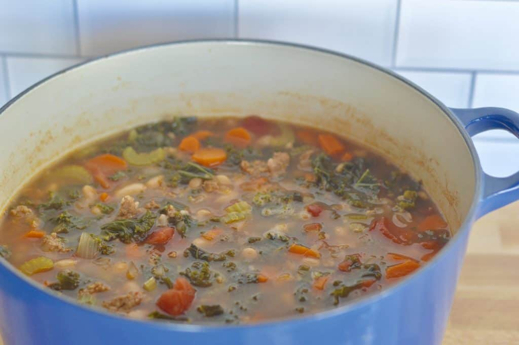 large blue dutch oven full Italian tuscan stew.