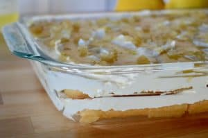 side view of limoncello tiramisu in a glass baking dish.