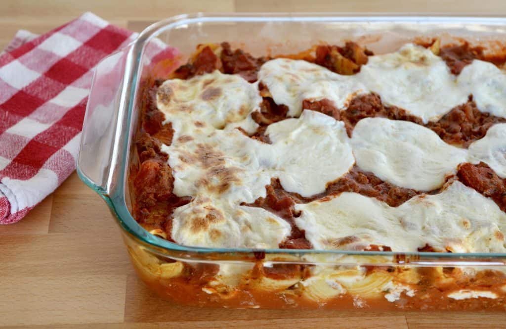 Cheese beef Stuffed Shells in a glass baking dish.