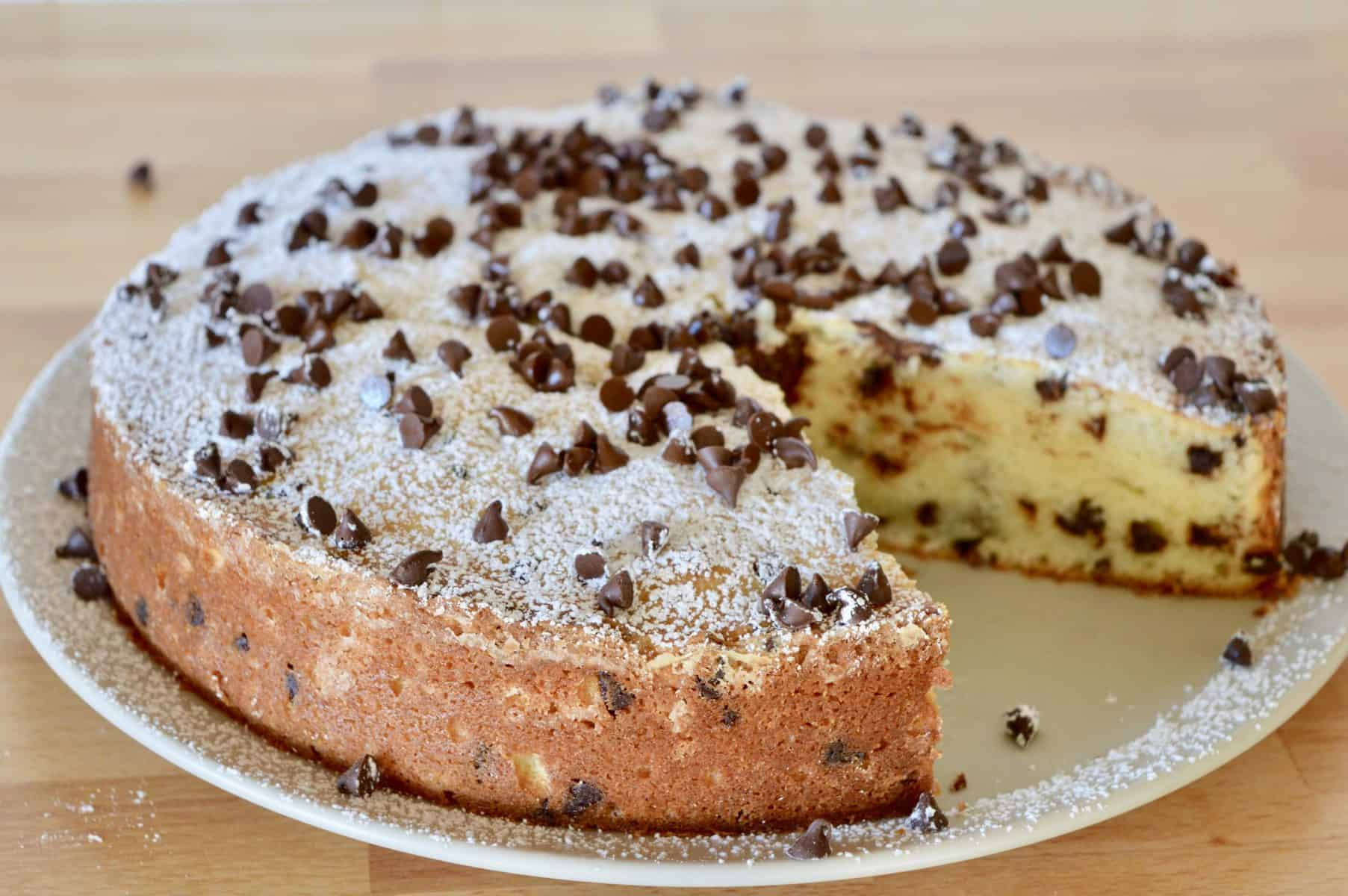 Chocolate Chip Ricotta Cake with a slice missing from it.