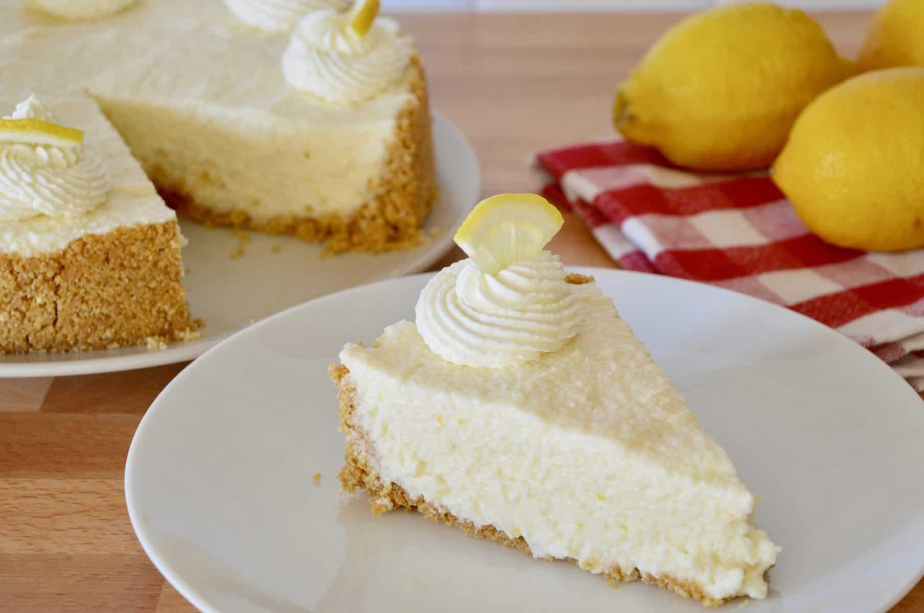 No-Bake Lemon Mascarpone Cheesecake sliced on a plate.