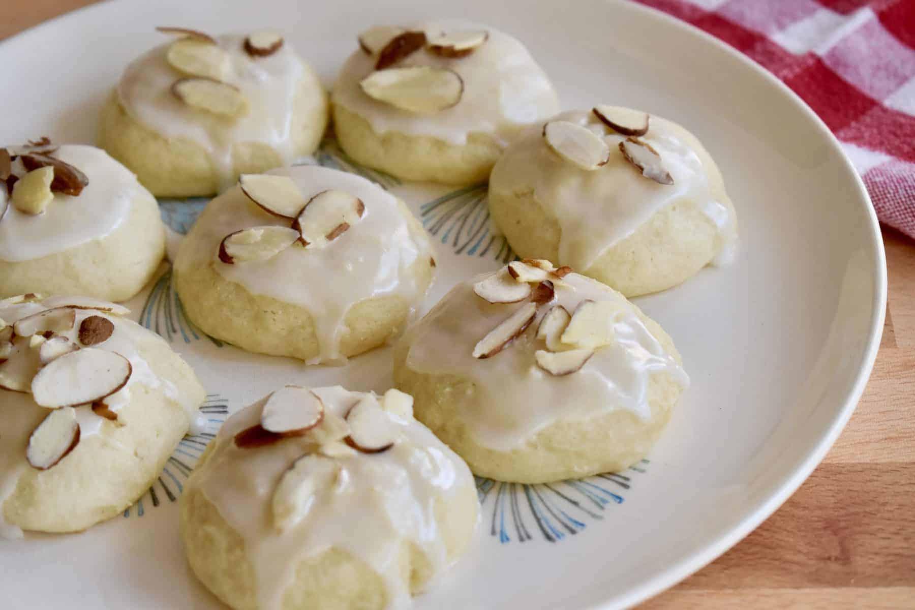 Italian Almond Ricotta Cookies on a white plate.