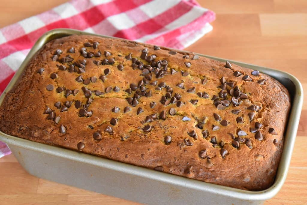 Baked loaf with chocolate chips sprinkled on top.