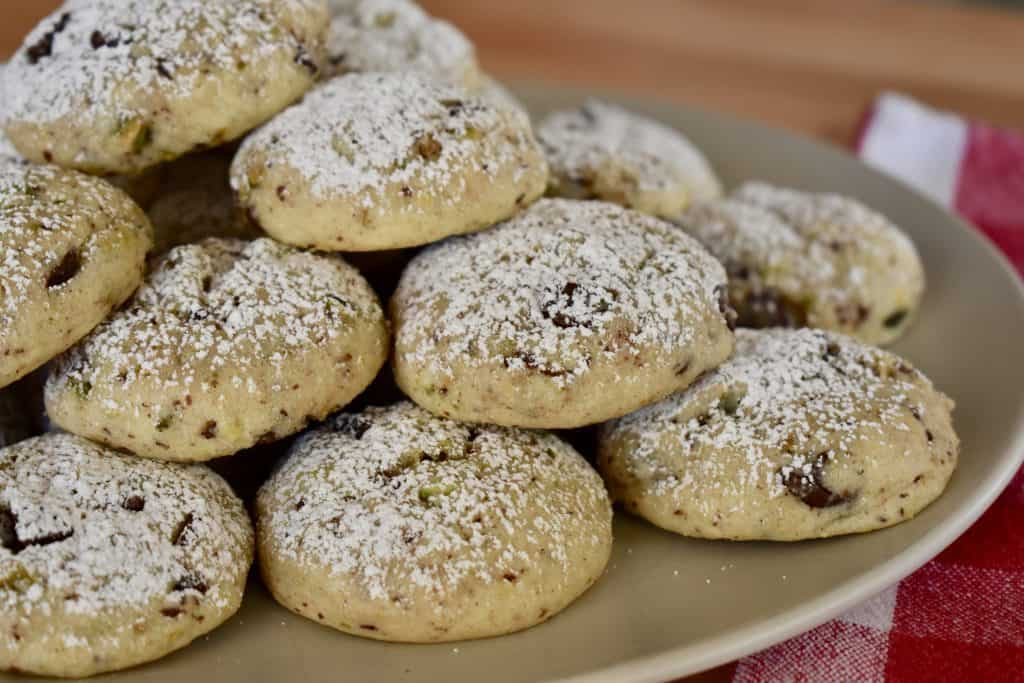 Cannoli Cookies stacked high on a plate.