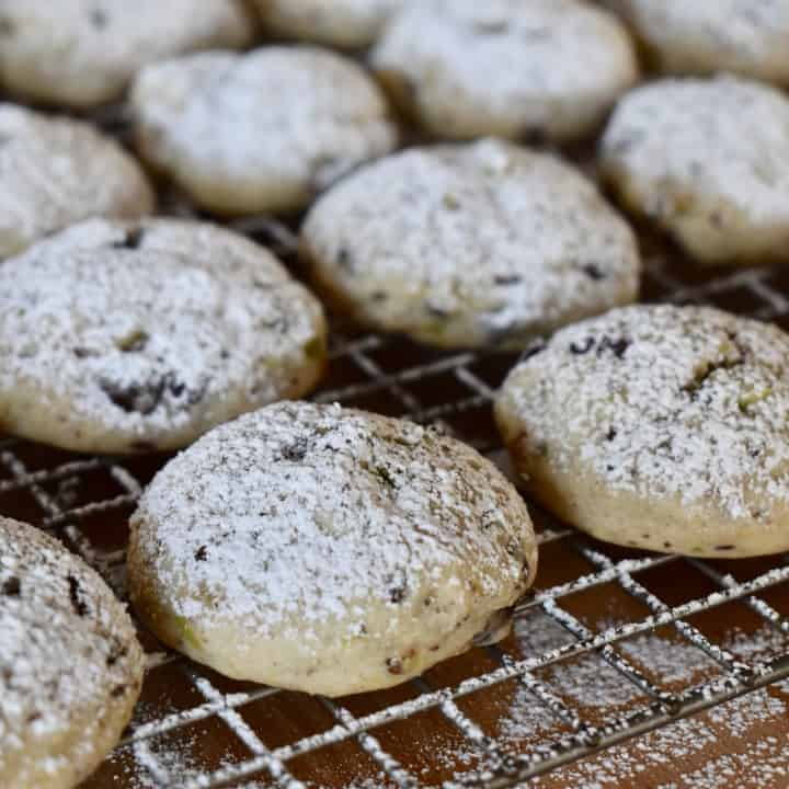 powdered sugar spindled on top of the cooled cookies on a baking rack.