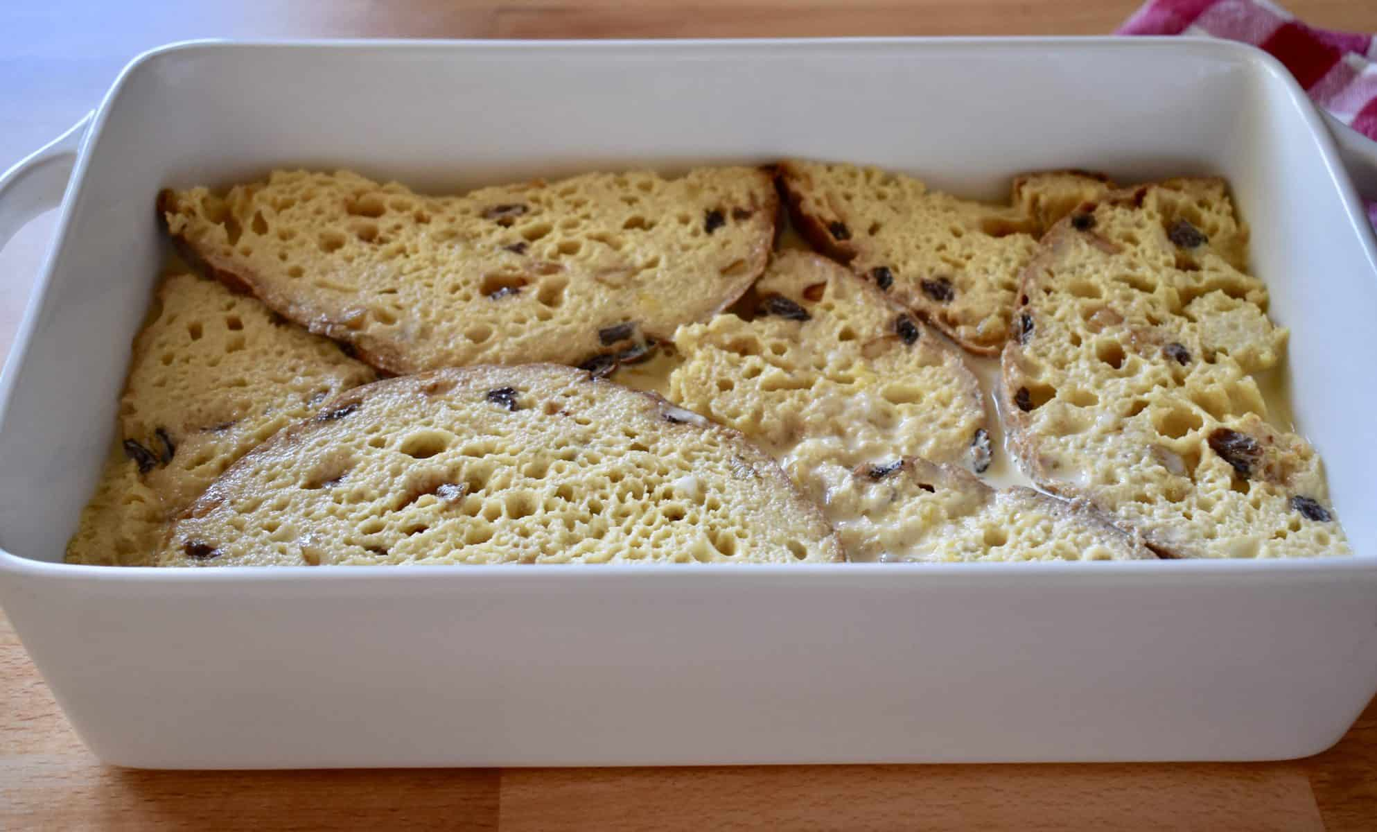 panettone French toast casserole in a white pan ready to bake.