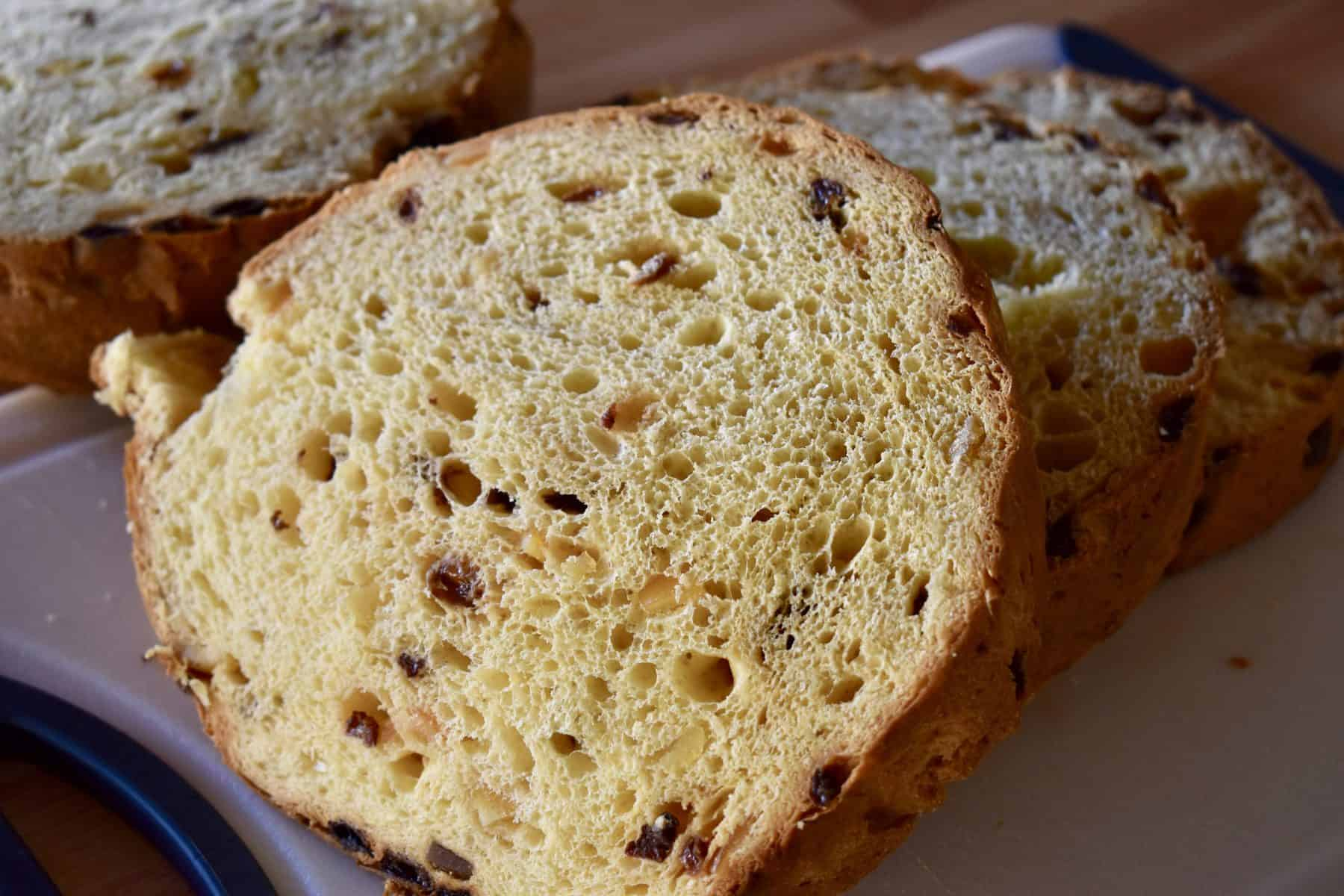 Sliced Panettone on a white cutting board.