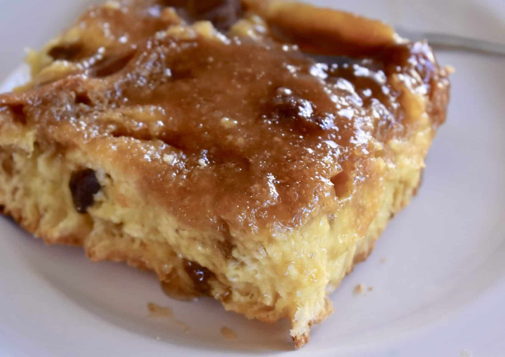 Panettone French Toast Casserole with brown sugar topping on a white plate.