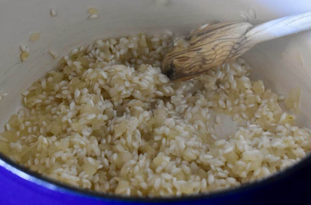 wine added to the arborio rice in a large pot.