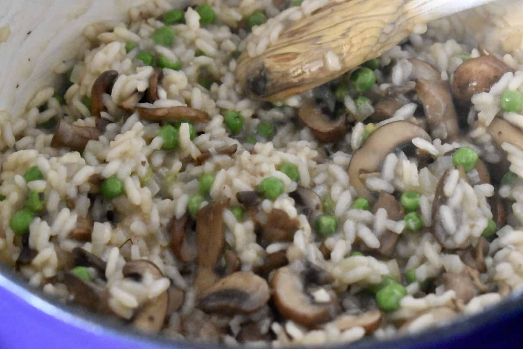 Peas added to the pot of risotto.
