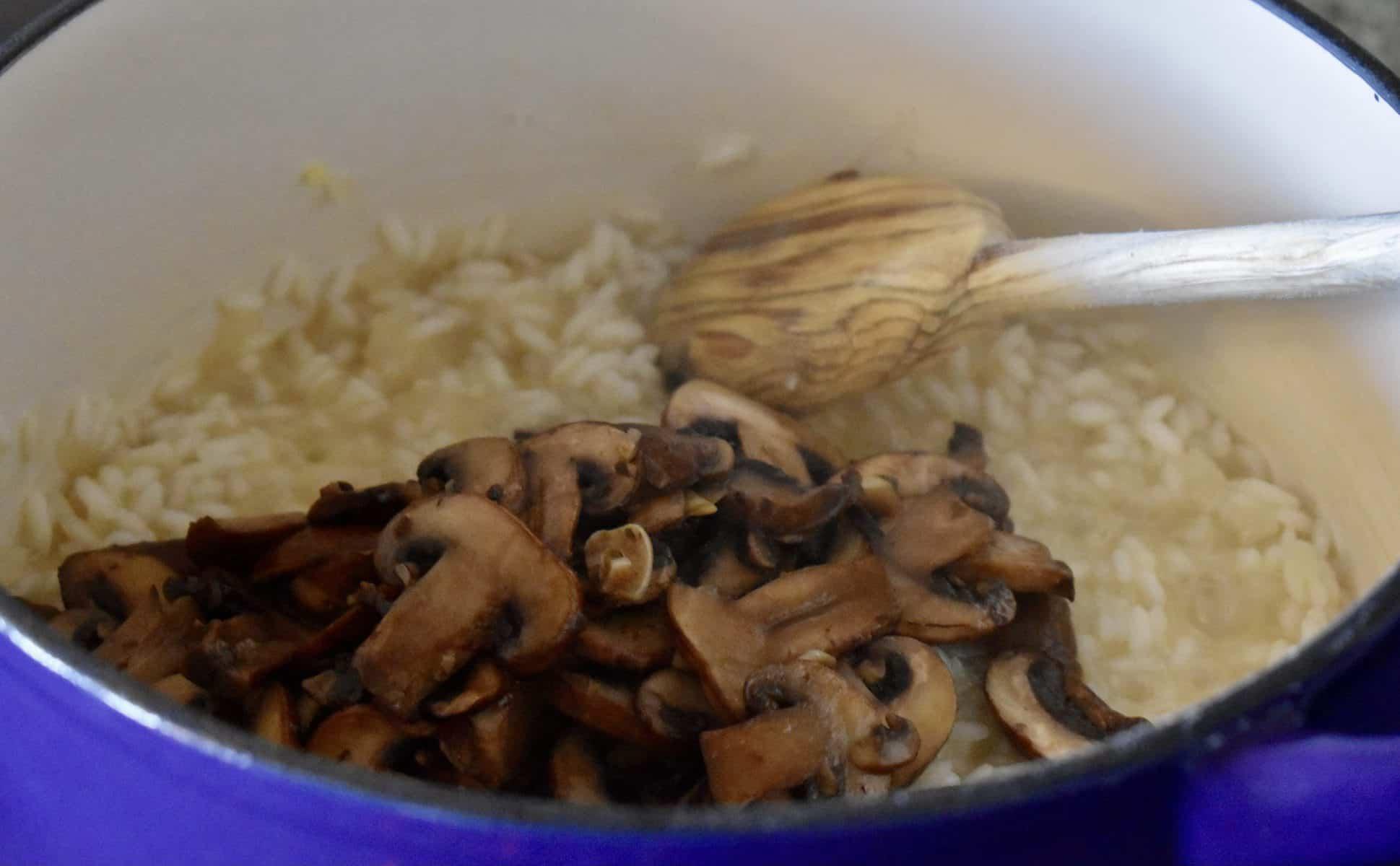 Mushrooms added to the pot of arborio rice.