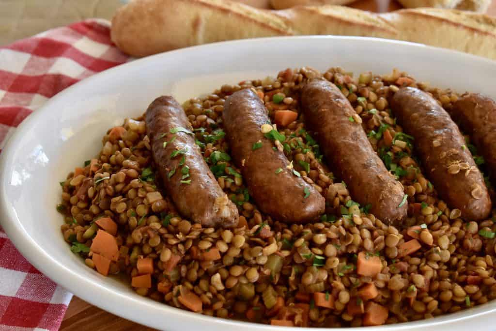 Italian Sausage and Lentils on a white serving platter.