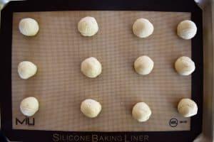 balls of dough on a lined sheet pan.