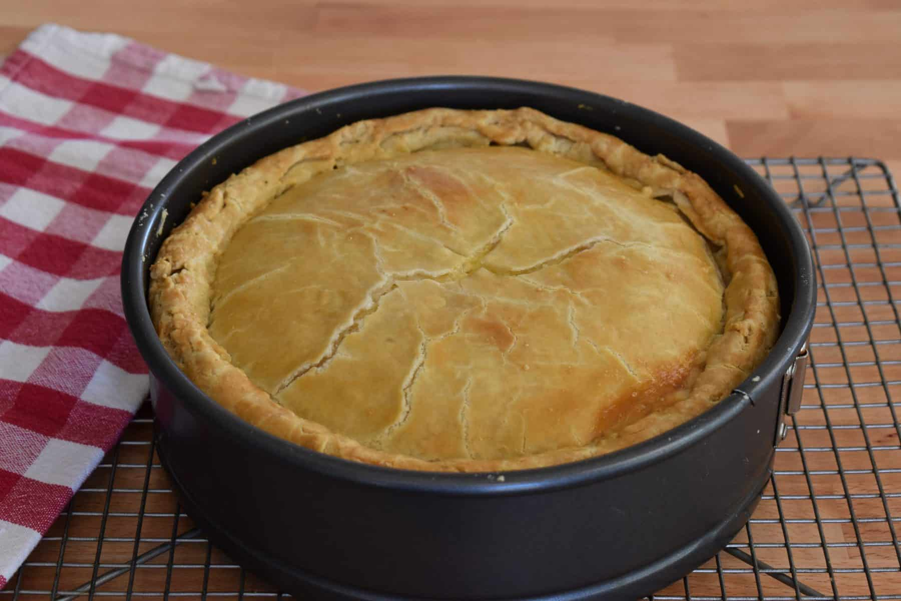 Italian Easter Pie in a springform pan on a cooling rack.