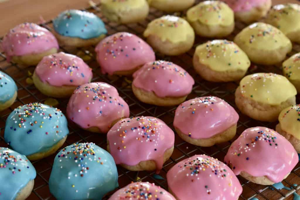 Italian Easter Cookies in pink, yellow, and blue.