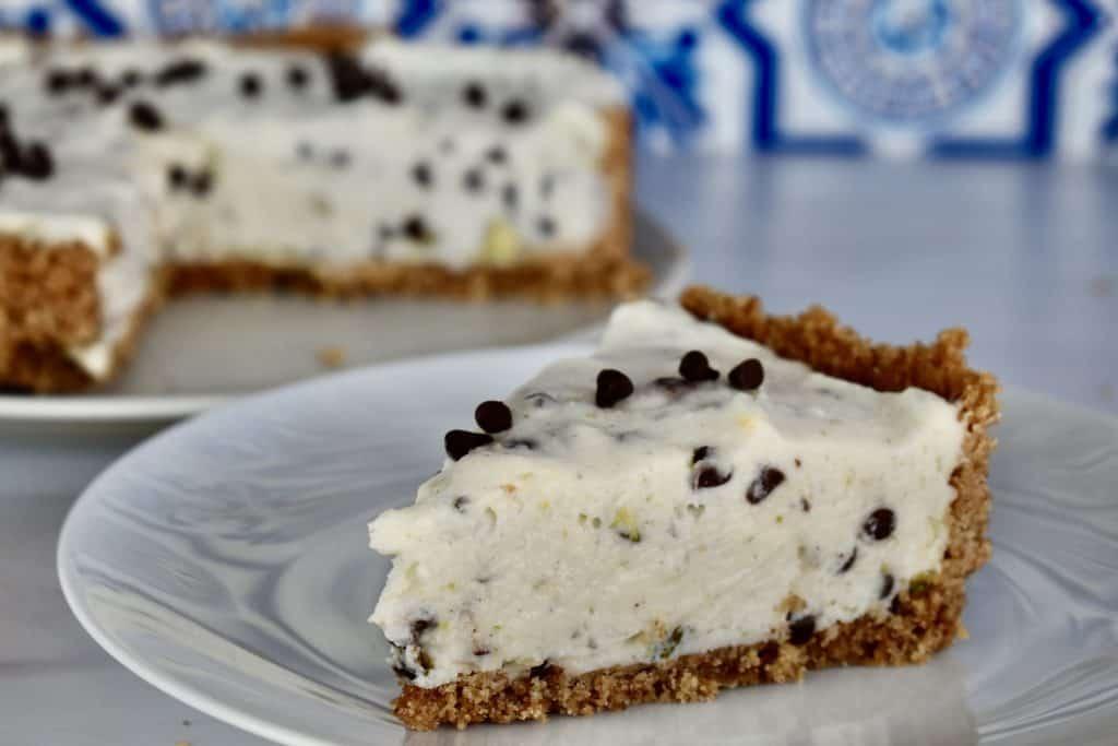 slice of No Bake Cannoli Cheesecake on a white plate.