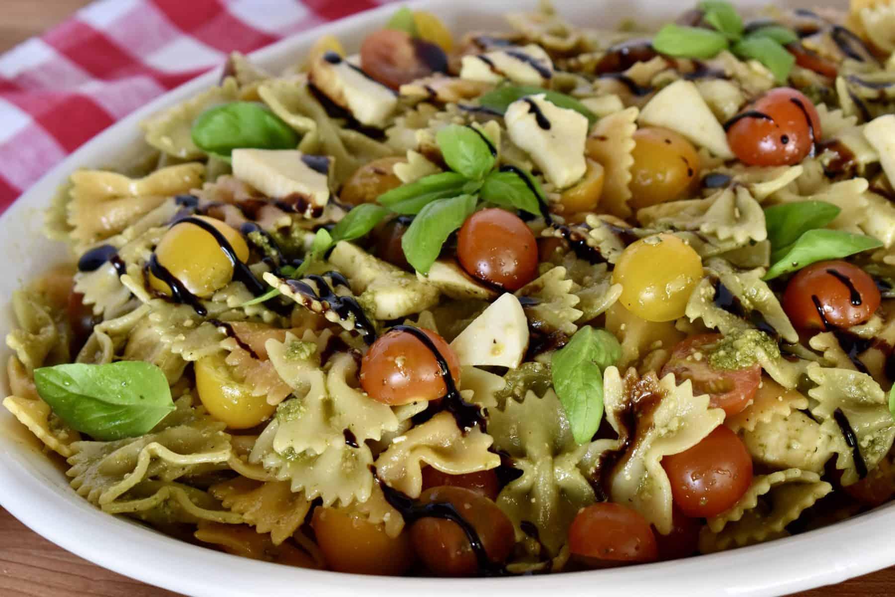 Pesto pasta Salad on a white serving platter.